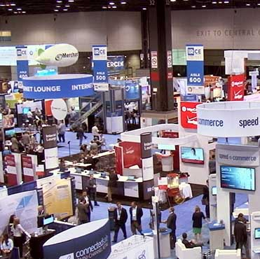Photo of an Event's Exhibition Hall with Booths and Attendees.  Event security is a specialty of Maloney Security.
